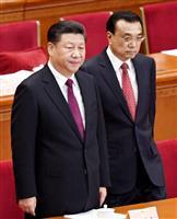 北京の人民大会堂で開幕した中国人民政治協商会議に臨む習近平国家主席(左)と李克強首相(共同)