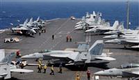 米韓合同軍事演習で航空母艦、カールビンソンの甲板で発艦準備をするF18=3月3日、韓国(ロイター)