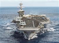 豪州から朝鮮半島へ向きを変えた原子力空母カール・ビンソン (米海軍提供・ロイター)