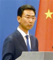 中国外務省で記者会見する耿爽副報道局長=14日、北京(共同)