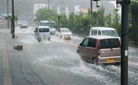 台風5号による大雨で冠水した市街地の道路=5日午後、鹿児島県奄美市