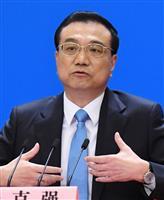 中国全人代が閉幕し、記者会見する李克強首相=20日、北京の人民大会堂(共同)