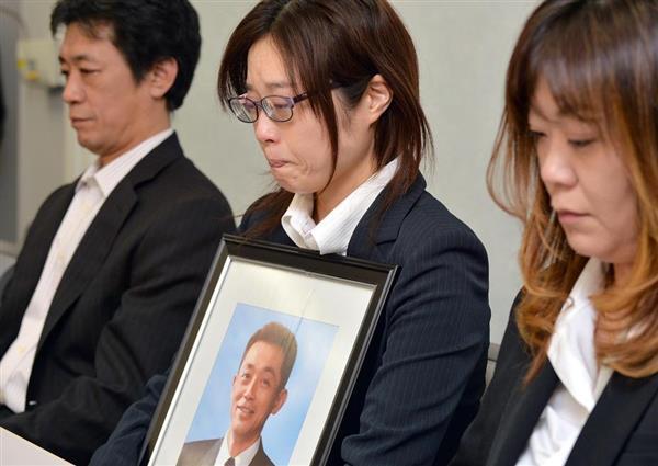 判決後の記者会見で悔しさを訴えた川上幸伸さんの遺族ら=大阪市北区