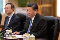 中国の習近平国家主席(中央)=6月25日、北京(ロイター)