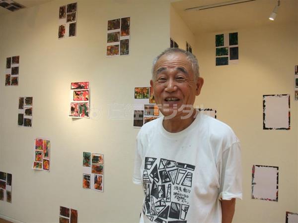 レイアウトを終えたばかりの個展会場で熱っぽく語る堀尾貞治さん=大阪市中央区