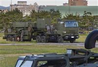撤収に向け、トラックに連結されたPAC3の発射機=30日午後、陸上自衛隊函館駐屯地