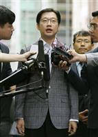 特別検察官の捜査チームの事務室に出頭する金慶洙・慶尚南道知事=6日、ソウル(聯合=共同)