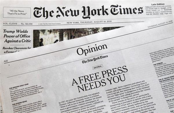 16日、報道の自由を訴える社説を掲載した米ニューヨーク・タイムズ(AP)