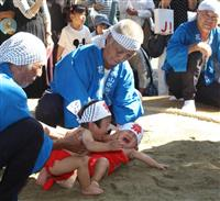 わが子の成長願い「泣き相撲」 海南、全国から男児140人参加