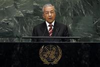 マレーシア、ウイグル族11人釈放 中国の送還要求拒否