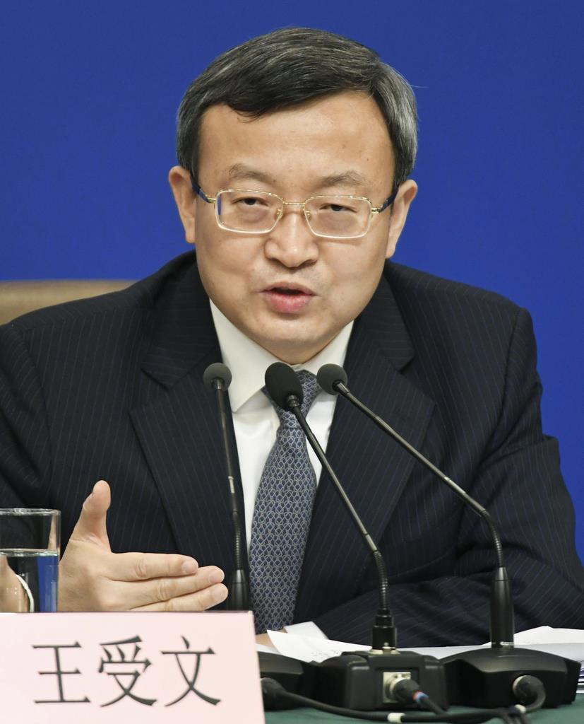 記者会見する中国の王受文商務次官=9日、北京(共同)
