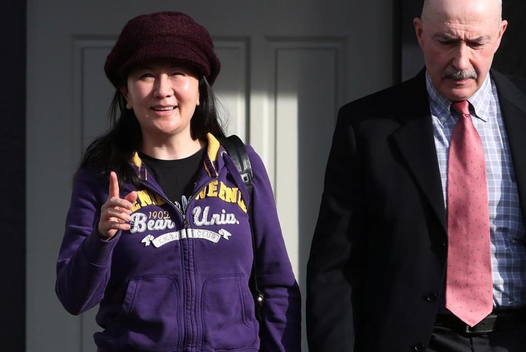 3月6日、カナダ・バンクーバーの裁判所へと向かうファーウェイ副会長の孟晩舟被告(ロイター)