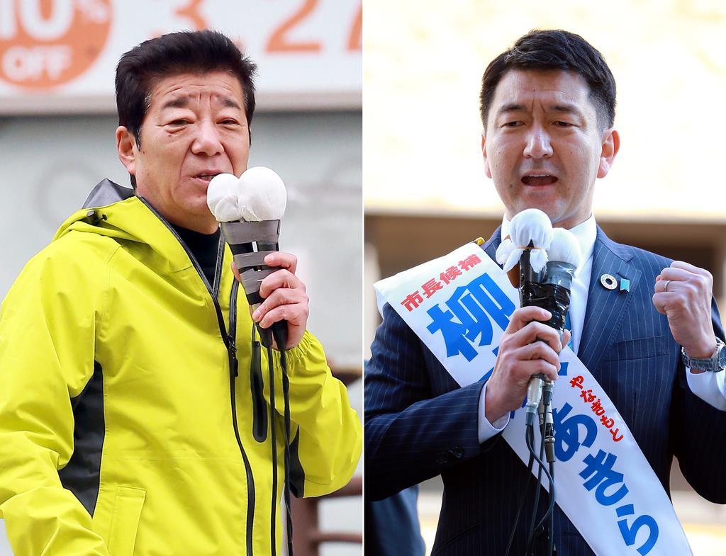 大阪市長選に立候補した柳本顕候補(右)と松井一郎候補=24日午後、大阪市中央区(渡辺恭晃撮影)