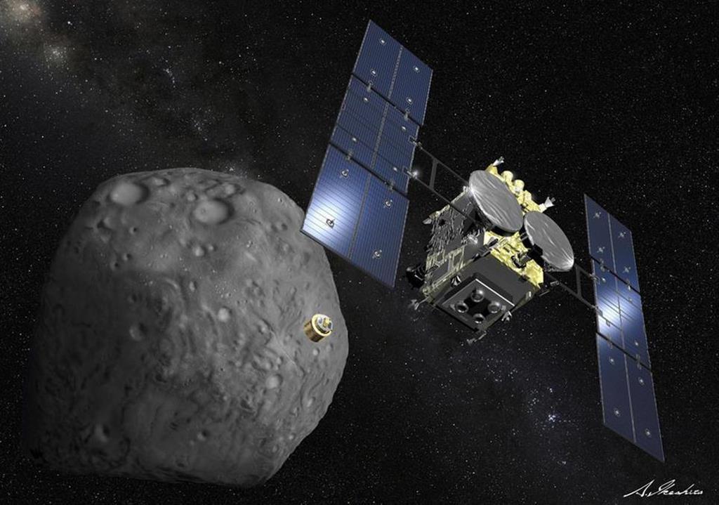 小惑星表面に人工のクレーターをつくる「衝突装置」を分離するはやぶさ2の想像図(JAXA提供)