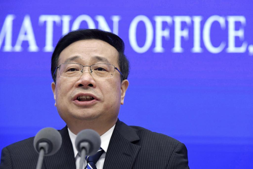 2019年1~3月期のGDP速報値を発表する中国国家統計局の報道官=17日、北京(共同)