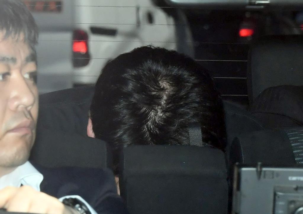 傷害致死の罪で起訴された根本智紀被告。写真は5月22日の逮捕直後=東京都品川区の品川警察署(川口良介撮影)