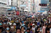 香港で再び抗議デモ 九竜地区車道占拠し行進