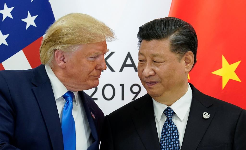 6月に大阪で行われたG20サミットで会談したトランプ米大統領(左)と中国の習近平国家主席(ロイター)