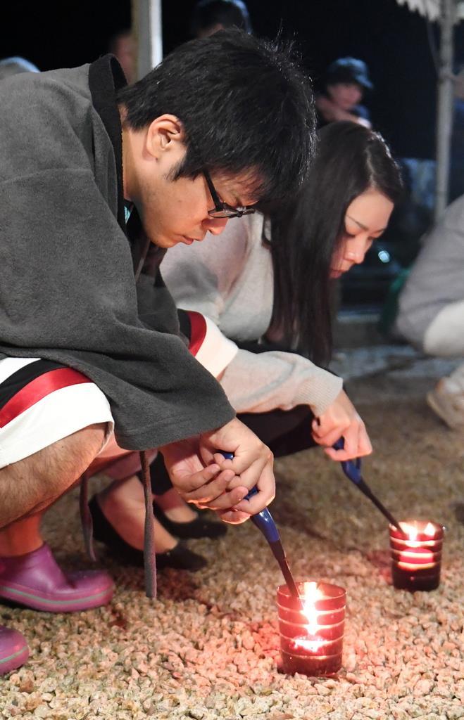 和歌山県那智勝浦町の慰霊祭に参加した寺本圭太さん。地域のために働くことを誓った=4日午前1時2分(安元雄太撮影)