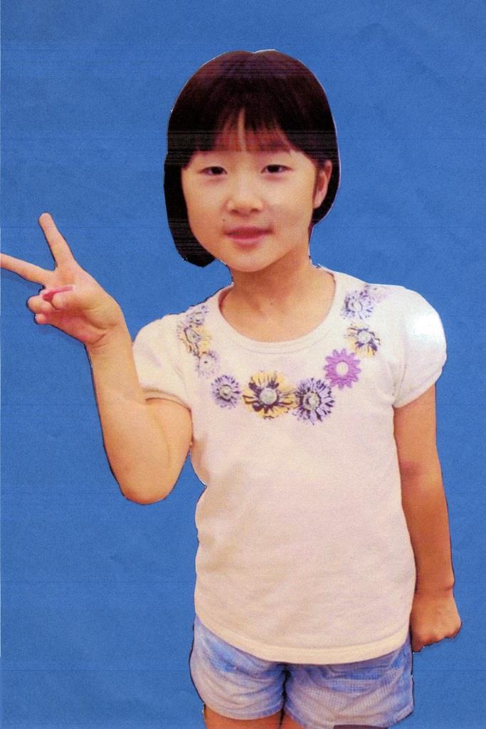 山梨県警が公開した、行方不明になっている小倉美咲さんの写真
