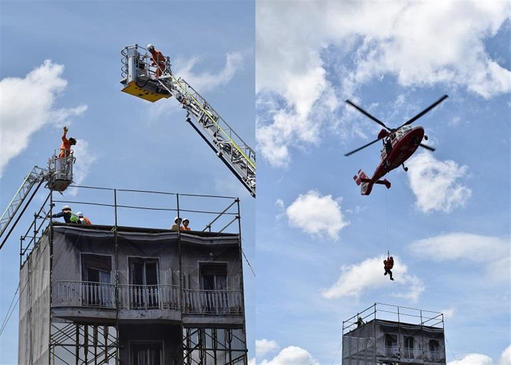 はしご車とヘリを使った座屈ビル・倒壊建物救出訓練。本格的な訓練が行われた
