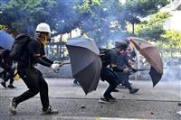 重体の高校生、乱闘中に至近距離から被弾 香港