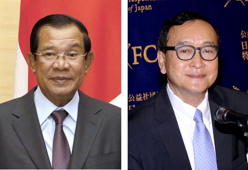 カンボジアのフン・セン首相(左)と、解党に追い込まれたカンボジア救国党元党首のサム・レンシー氏