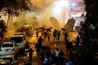 中国、覆面禁止法「違憲」に反発 「重大な懸念」香港司法への圧力強化へ
