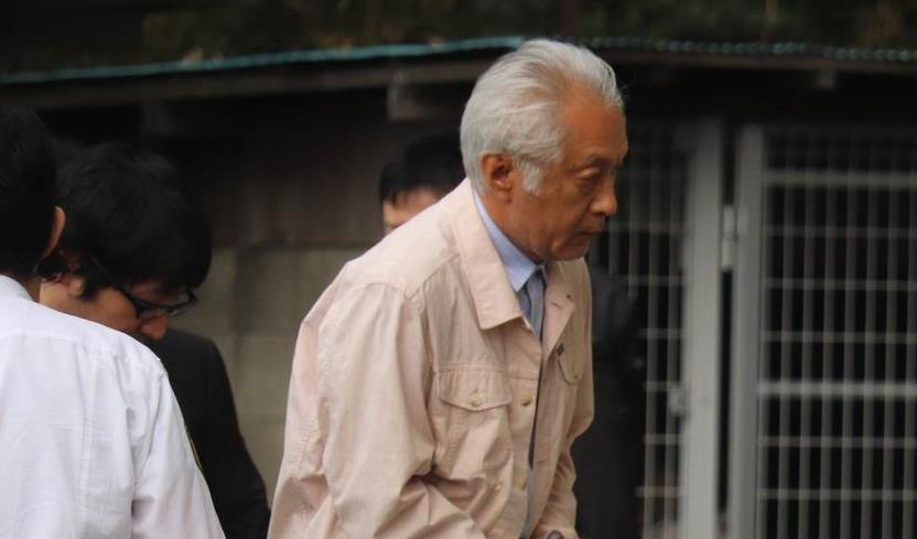 逮捕された石橋典昭容疑者=25日、千葉県警八千代署(白杉有紗撮影)