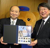 切手「辰鼓楼とコウノトリ」発売 兵庫・但馬の64郵便局