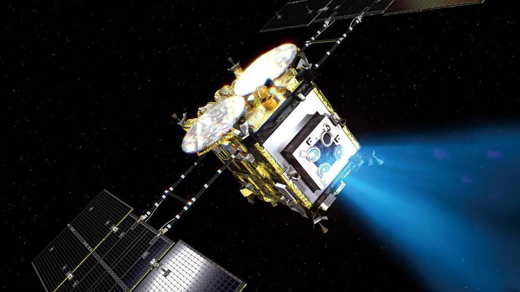 イオンエンジンを噴射して進む小惑星探査機「はやぶさ2」の想像図(JAXA提供)