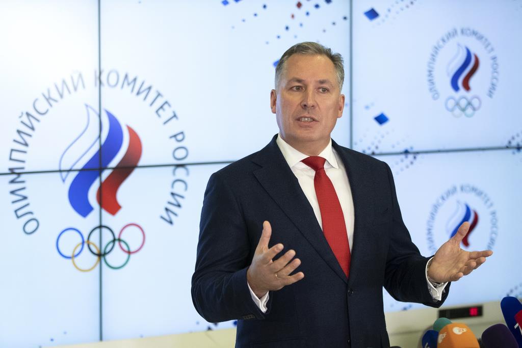 記者会見するロシアオリンピック委員会のスタニスラフ・ポズニャコフ会長=11月28日、モスクワ(AP)