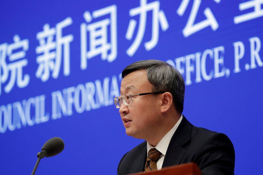 13日、米政権との貿易協議について会見する中国商務省の王受文次官=北京(ロイター)
