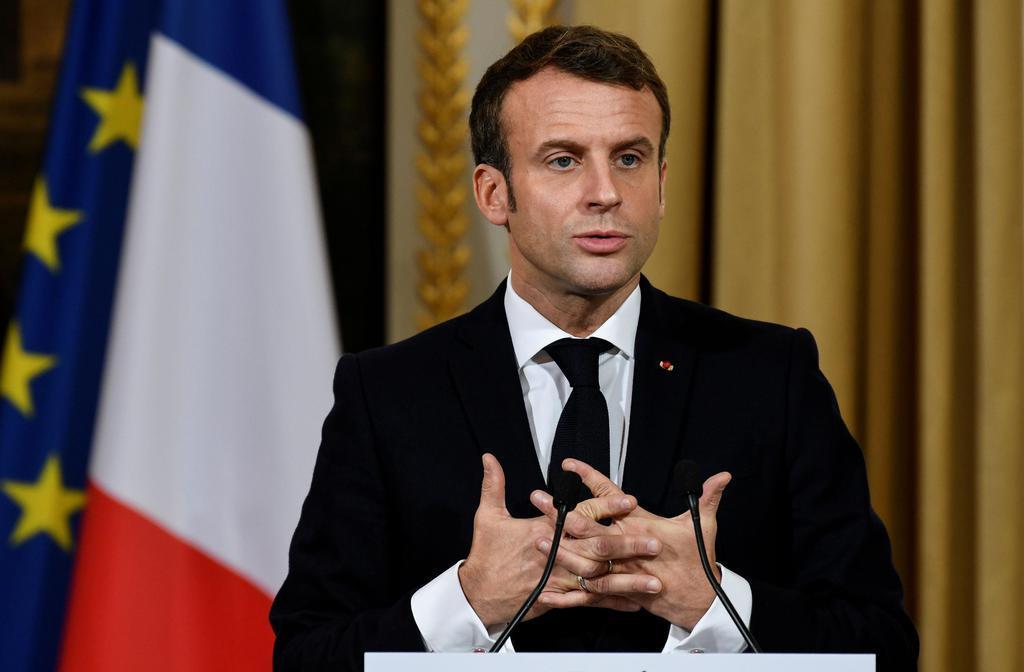 フランスのマクロン大統領=28日、パリ(ロイター)