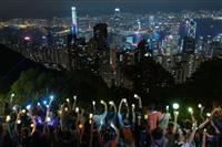 香港で追悼集会 駐留解放軍は合同訓練