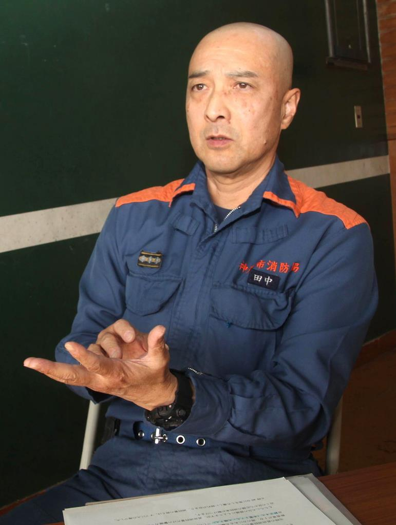 阪神大震災直後の火災現場での活動を振り返る田中進消防士長