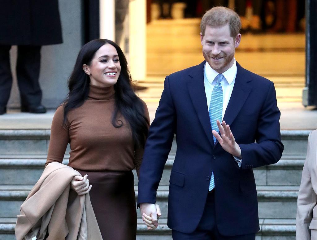 英王室のヘンリー王子と妻メーガン妃=7日、ロンドン(ゲッティ=共同)