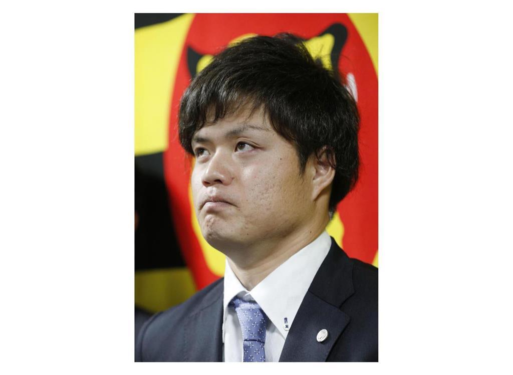 阪神の守屋投手が暴行否定 妻がモラハラと主張