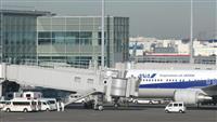 救急車待機の中、到着の第2便 防護服姿の関係者も 羽田空港