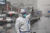 中国の感染者7万人超える 新型肺炎、死者は1765人
