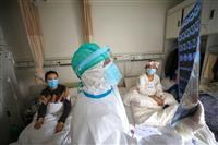 新型コロナ 武漢で退院後に男性死亡 退院一時停止も