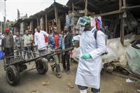 アフリカ感染者千人超える 急増にも外出制限に二の足