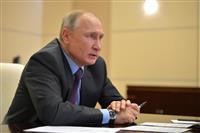 【赤の広場で】浮かぶプーチン氏の顔