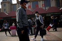 北京で新型コロナ警戒レベル引き下げ 隔離措置緩和、全人代開催に向け環境整備も