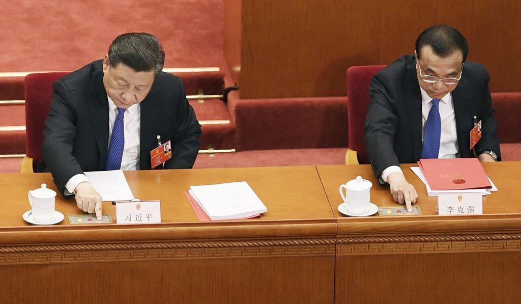 中国、批判覚悟で統制強化へ 香港関連議案採択