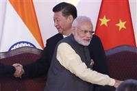 対中国、新型コロナ、バッタ…三重苦に悩むモディ政権