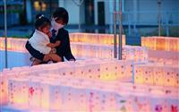 西日本豪雨2年 真備町で追悼の「万燈会」