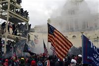 米首都暴動、死者4人に 警察、暴徒双方が化学物質使用