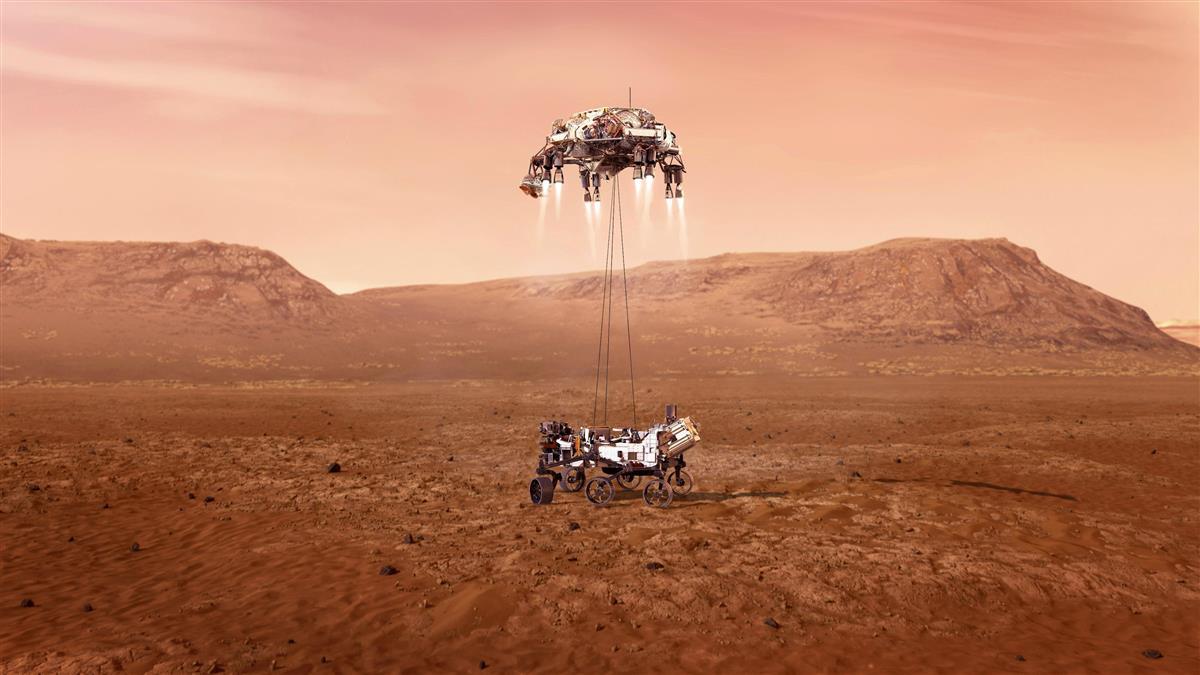 母船からつり下げられ火星に着陸する探査車パーシビアランスの想像図(NASA提供・共同)