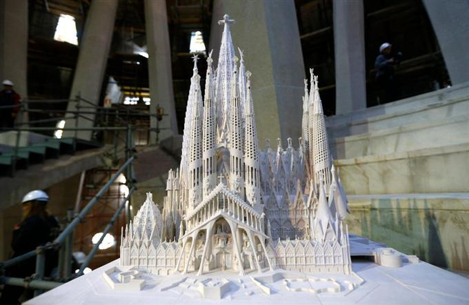 A model of the Sagrada Familia Basilica designed by architect Antoni Gaudi is displayed at the Sagrada Familia Basilica in Barcelona, Spain, Wednesday, Oct. 21, 2015.  Barcelona's breathtaking La Sagrada Familia Basilica has begun its final phase of raising six immense towers. Presenting the project Thursday, chief architect Jordi Fauli said the central
